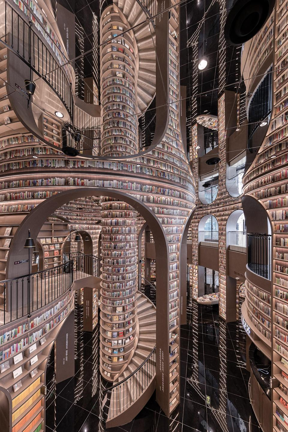 The architects went to great lengths in ensuring the lighting was such that each shelf provided a visual impact, while allowing visitors ease in finding specific books.