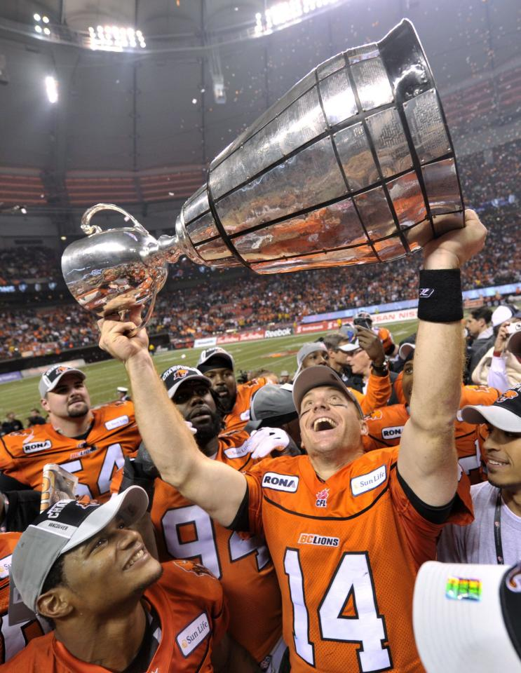 B.C. Lions quarterback Travis Lulay hoists the Grey Cup after beating the Winnipeg Blue Bombers 34-23 in the 99th CFL Grey Cup football game on Sunday, Nov. 27, 2011, in Vancouver, British Columbia. (AP Photo/The Canadian Press, Nathan Denette)