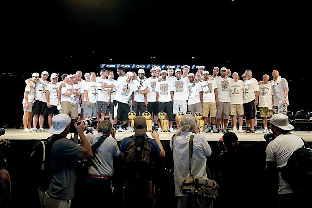 The San Antonio Spurs appear on stage during the victory celebration at the Alamodome. (Gary Miller/Getty Images)