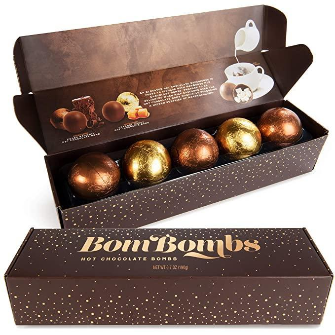 """<h3>Bombombs Hot Chocolate Bombs</h3><br>Hot chocolate bombs may be the 2021 food trend we never saw coming, but we're here for it. Get an explosion of flavor in your cup with this assorted chocolate set.<br><br><strong>Thoughtfully</strong> Bombombs Hot Chocolate Bombs, $, available at <a href=""""https://amzn.to/35DAJnR"""" rel=""""nofollow noopener"""" target=""""_blank"""" data-ylk=""""slk:Amazon"""" class=""""link rapid-noclick-resp"""">Amazon</a>"""