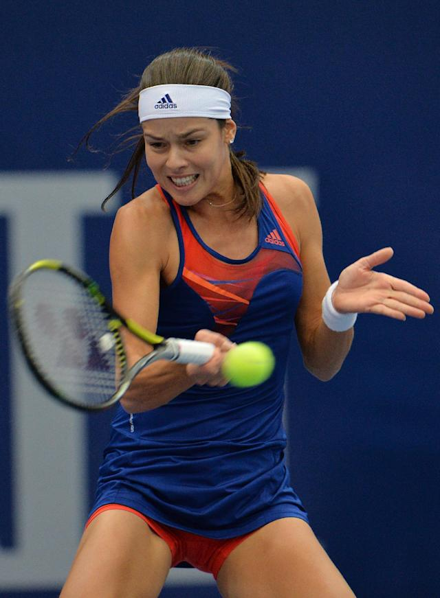 Serbia's Ana Ivanovic returns the ball to Germany's Angelique Kerber during their final match of the Generali Ladies tennis tournament in Linz, Austria, Sunday, Oct. 13, 2013. (AP Photo/Kerstin Joensson)