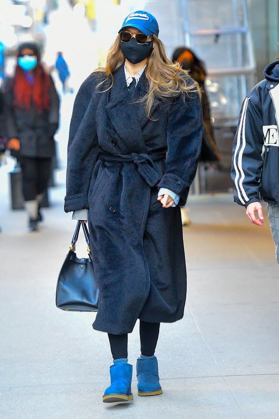 <p>Gigi Hadid is barely recognizable under a baseball cap, sunglasses and face mask as she bundles up to head to a photo shoot in N.Y.C. on Saturday.</p>