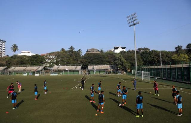 Punjab Football club players are seen during a training session before their match with Indian Arrows at the Cooperage football ground in Mumbai