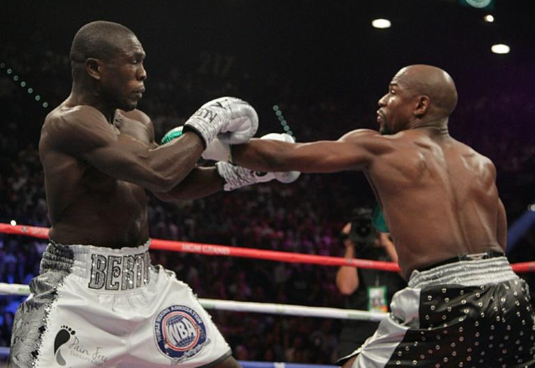 Floyd Mayweather (R) and Andre Berto fight for the WBO Welterweight World Title at the MGM Grand Garden Arena in Las Vegas, Nevada on September 12, 2015