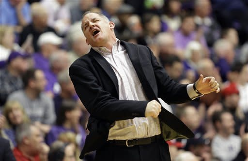 Portland head coach Eric Reveno reacts from the bench during the first half of an NCAA college basketball game against Gonzaga in Portland, Ore., Thursday, Jan. 17, 2013. (AP Photo/Don Ryan)