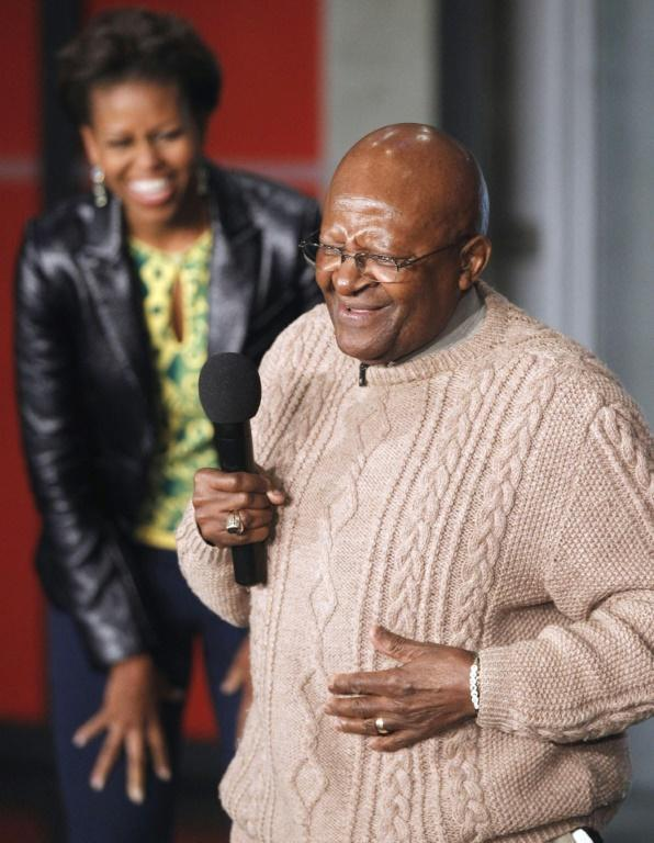 On June 23, 2011, US First Lady Michelle Obama and Archbishop Desmond Tutu, speak to youths before taking part in HIV awareness raising activities in Cape Town (AFP/CHARLES DHARAPAK)