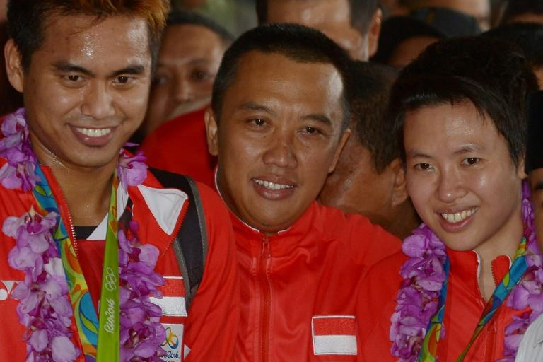 Imam Nahrawi (centre) was jailed for seven years after being found guilty of corruption
