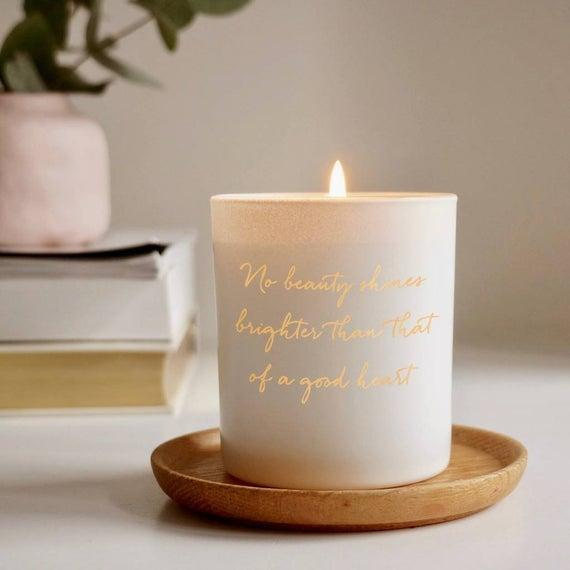 """<h3>Illumer Personalized Quote Candle</h3><br>Instead of opting for the traditional candle, upgrade your gift idea with their favorite motivational phrase or movie quote. You can even add an engraved lid to make this present unlike any other candle they already own. <br><br><em>Shop </em><a href=""""https://www.etsy.com/shop/Illumer"""" rel=""""nofollow noopener"""" target=""""_blank"""" data-ylk=""""slk:Illumer"""" class=""""link rapid-noclick-resp""""><strong><em>Illumer</em></strong></a><br><br><strong>Illumer</strong> Personalized Quote Candle, $, available at <a href=""""https://go.skimresources.com/?id=30283X879131&url=https%3A%2F%2Fwww.etsy.com%2Flisting%2F605624736%2Fpersonalised-quote-candle-personalised"""" rel=""""nofollow noopener"""" target=""""_blank"""" data-ylk=""""slk:Etsy"""" class=""""link rapid-noclick-resp"""">Etsy</a>"""