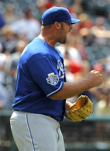 Kansas City Royals relief pitcher Jonathan Broxton reacts after getting the final out in the ninth inning of the Royals 6-3 win over the Cleveland Indians in a baseball game in Cleveland on Wednesday, May 30, 2012. (AP Photo/Amy Sancetta)