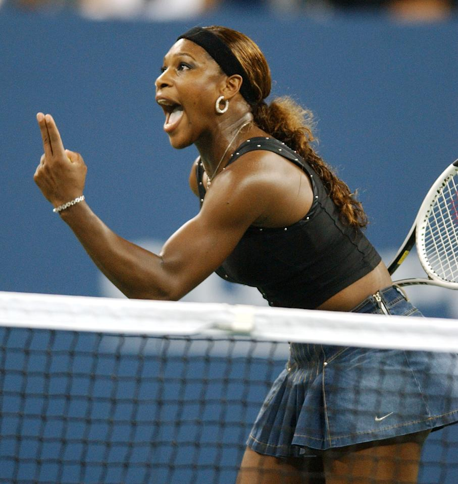 Serena Williams, of the United States, questions a call during her match with Jennifer Capriati, of the United States, at  the U.S. Open tennis tournament in New York, Tuesday, Sept. 7, 2004.  (AP Photo/ Bill Kostroun)
