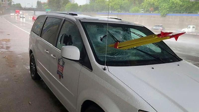 A car sits on the edge of a Cailfornian highway with a stolen tripod through its windscreen.