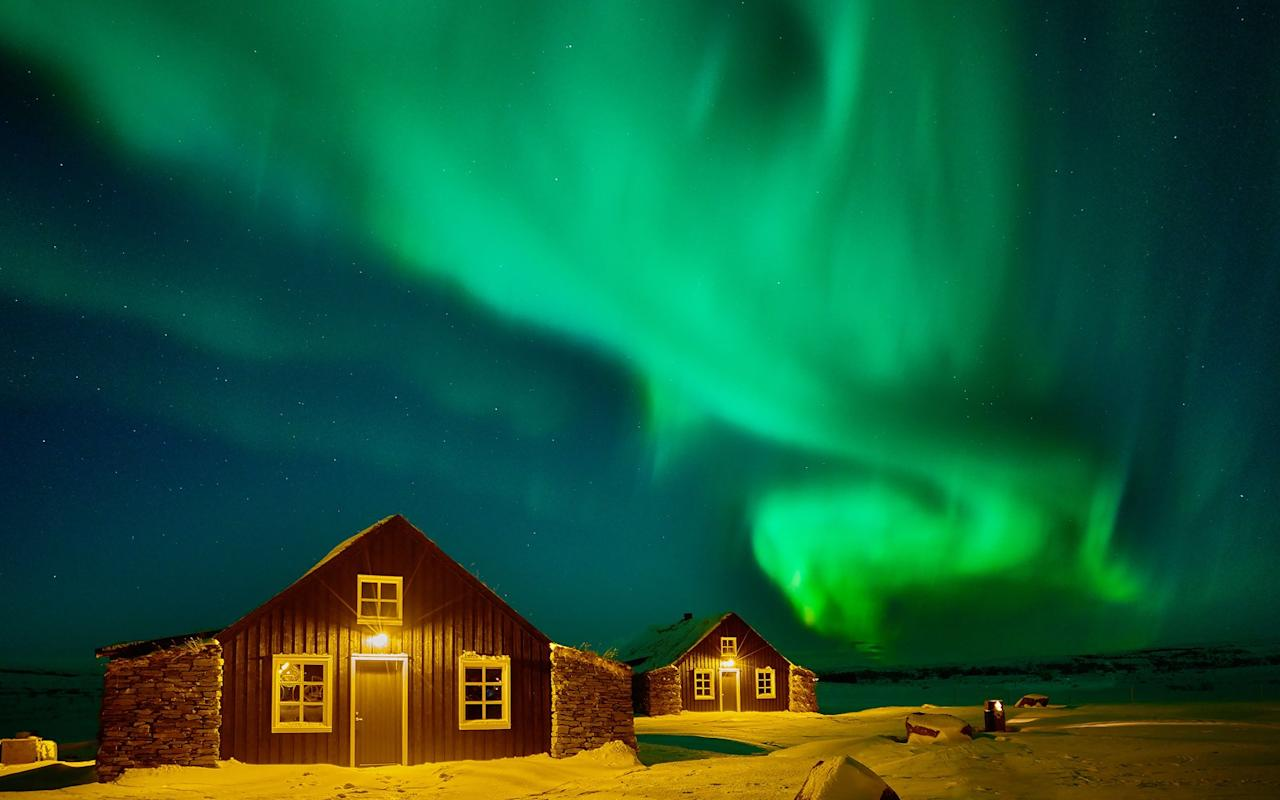 """<p>These cabins are located near Selfoss on <a href=""""https://www.travelandleisure.com/travel-tips/how-to-travel-to-iceland"""">Iceland's 'Golden Circle'</a> of tourist sites (which includes the <a href=""""https://www.thingvellir.is/en/"""">Þingvellir National Park</a>, Gullfoss waterfall, and the Great Geysir), but miles from any roads. With no light pollution to obstruct the experience, the <a href=""""http://www.torfhus.is"""">Torfhus Retreat</a> ($1,185 per person for three nights) is the perfect place to view the northern lights. Each residence comes complete with private, open-air, geo-thermally heated basalt stone pools, perfect for relaxing while watching the aurora ebb and flow across the sky.</p>"""