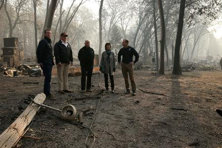 FILE PHOTO: U.S. President Donald Trump visits the charred wreckage of Skyway Villa Mobile Home and RV Park with then Governor-elect Gavin Newsom (L), FEMA head Brock Long (R), Paradise Mayor Jody Jones (2nd R) and Governor Jerry Brown in Paradise, California, Nov. 17, 2018.  REUTERS/Leah Millis/File Photo