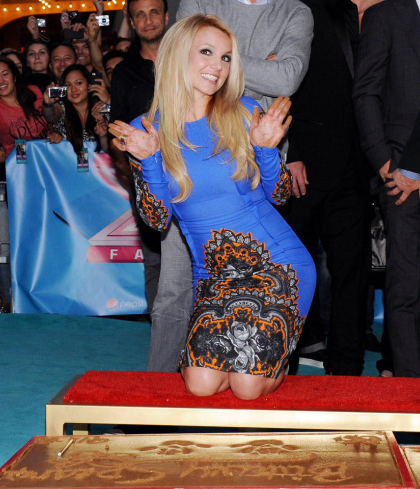 Britney Spears autographs cement at the 'The X Factor' Season 2 Premiere Party at Grauman's Chinese Theatre on September 11, 2012 in Hollywood, California.