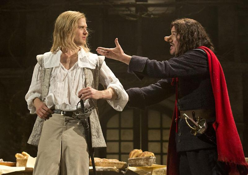"This theater image released by Boneau-Bryan/Brown shows Kyle Soller, left, and Douglas Hodge portraying the title role in ""Cyrano de Bergerac,"" playing at the American Airlines Theatre in New York. (AP Photo/Boneau-Bryan/Brown, Joan Marcus)"