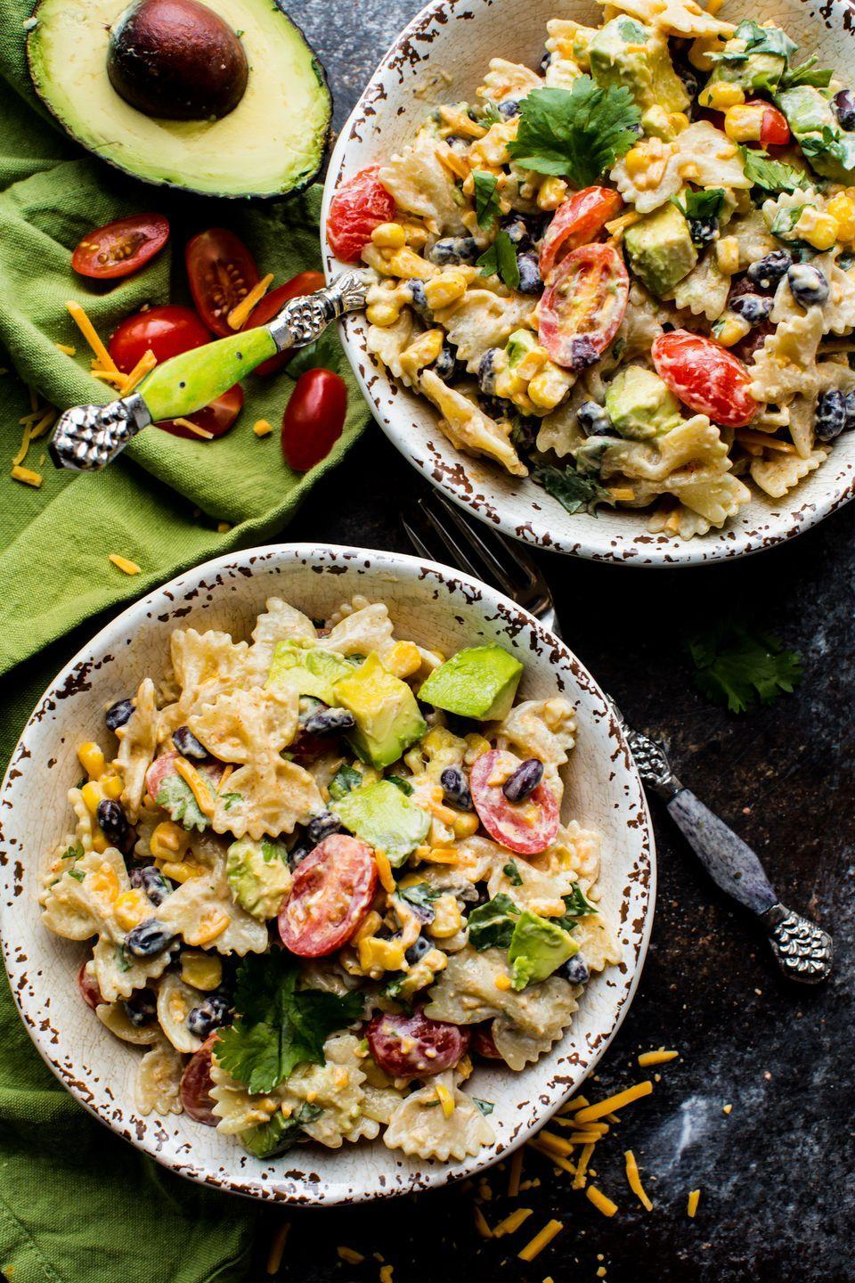 "<p>This kicked up pasta salad with a zesty Greek yogurt dressing is full of the fixings from zesty taco seasoning to cilantro, cheddar cheese, avocado, black beans, and corn. So easy to mix up ahead of time, too!</p><p>Get the recipe from <a href=""https://www.delish.com/cooking/recipe-ideas/recipes/a53448/southwestern-pasta-salad-recipe/"" rel=""nofollow noopener"" target=""_blank"" data-ylk=""slk:Delish"" class=""link rapid-noclick-resp"">Delish</a>.</p>"
