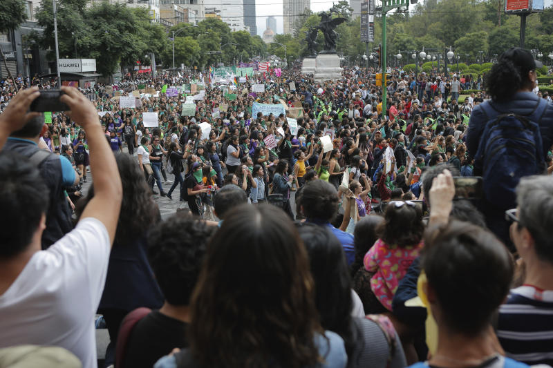 Women march for abortion rights in Mexico City, Saturday Sept. 28, 2019. Mexican women on Saturday marched on Saturday highlighting increased efforts across Latin America to lift some of the world's most restrictive abortion laws. (AP Photo/Anthony Vazquez)