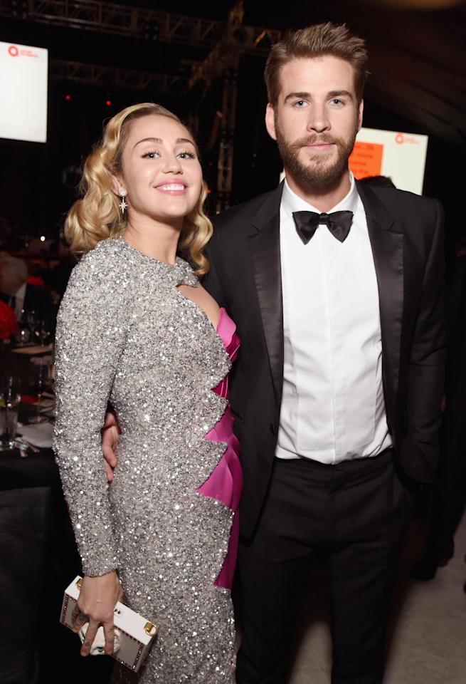 <p>Miley Cyrus and Liam Hemsworth give us some serious couple goals while attending the Elton John aids foundation Academy Awards viewing party in West Hollywood. See other celebrities who have attended the Oscar viewing parties.</p>
