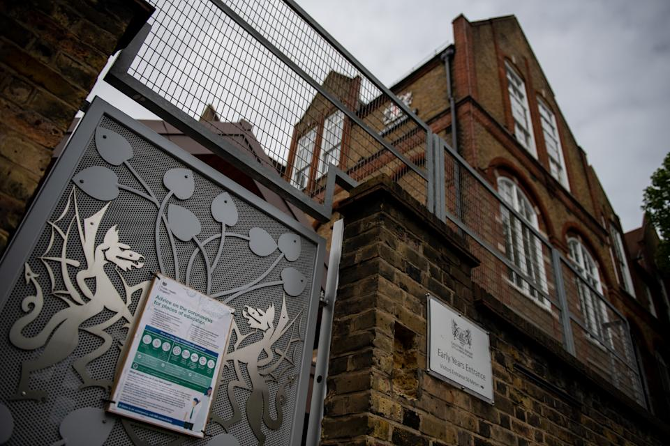 LONDON, ENGLAND - MAY 17: A sign on an entrance gate indicates advice on coronavirus at schools at the temporarily closed Galleywall Primary School on May 17, 2020 in London, England. The government has said schools in England can reopen as early as June 1, but teachers' unions have expressed concerns it is unsafe. Meanwhile, schools in Wales, Scotland and Northern Ireland may not restart before the summer holidays. (Photo by Chris J Ratcliffe/Getty Images)