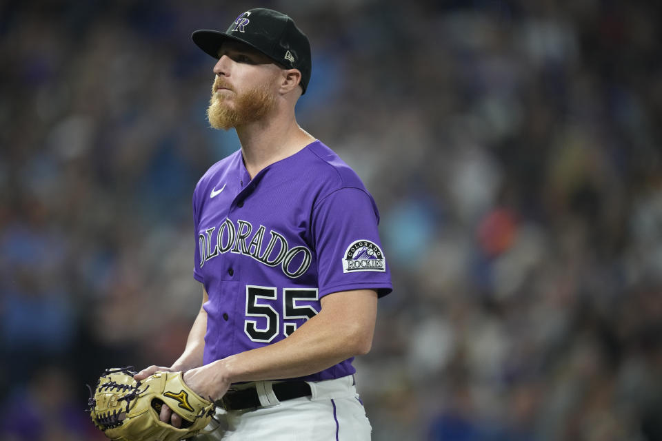 Colorado Rockies starting pitcher Jon Gray heads to the dugout after retiring Chicago Cubs' David Bote to end the top of the fifth inning of a baseball game Wednesday, Aug. 4, 2021, in Denver. (AP Photo/David Zalubowski)