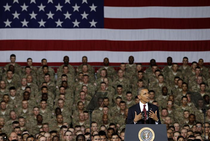 FILE - In this Aug. 31, 2012 file photo, President Barack Obama speaks to troops, service-members and military families at the 1st Aviation Support Battalion Hangar at Fort Bliss in El Paso, Texas. A new North Korean video portrays President Barack Obama and American troops in flames and says the North conducted its recent nuclear test because of U.S. hostility. (AP Photo/Tony Gutierrez, File)