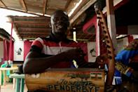 In revamping motenguene, the traditional kora instrument often gives way to the electric guitar