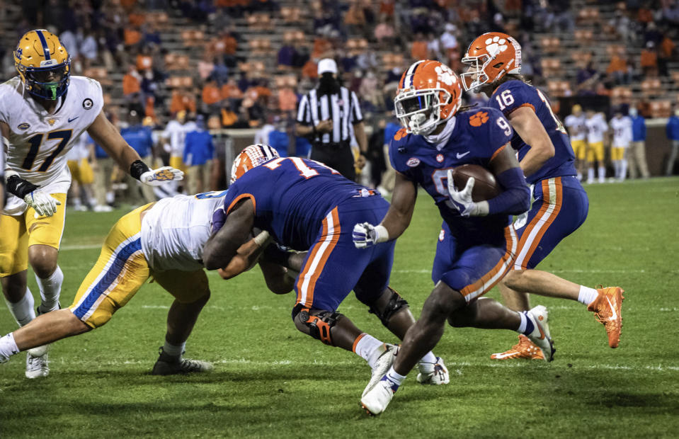 Clemson running back Travis Etienne (9) runs the ball during the third quarter of an NCAA college football game against Pittsburgh in Clemson, S.C., Saturday, Nov. 28, 2020. (Ken Ruinard/The Independent-Mail via AP, Pool)