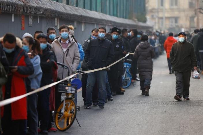 People line up to get their nucleic acid test following the outbreak of the coronavirus disease (COVID-19) in Beijing