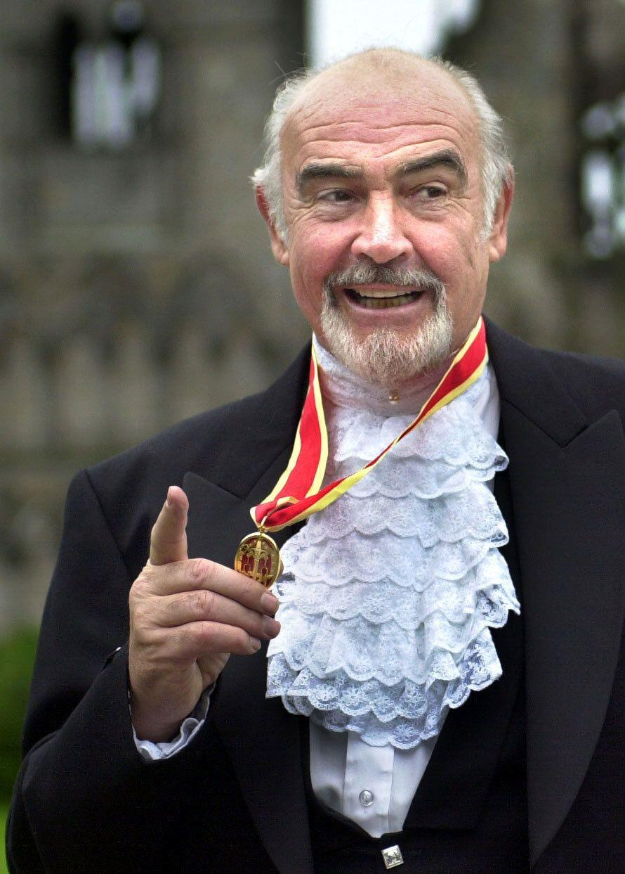 Sean Connery, donning full Highland dress and wearing his medal after he was formally knighted by the Queen during a investiture ceremony, at the Palace of Holyroodhouse in Edinburgh. (Photo: PA)