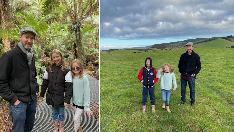 Owain Emslie with his two daughters in a rainforest, on a moor.