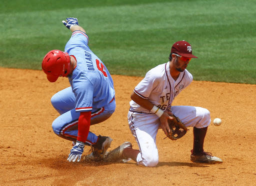 Mississippi's Thomas Dillard (6) beats the throw to Texas A&M infielder Braden Shewmake (8) as he slides in for a double during the third inning of a Southeastern Conference tournament NCAA college baseball game, Saturday, May 26, 2018, in Hoover, Ala. (AP Photo/Butch Dill)