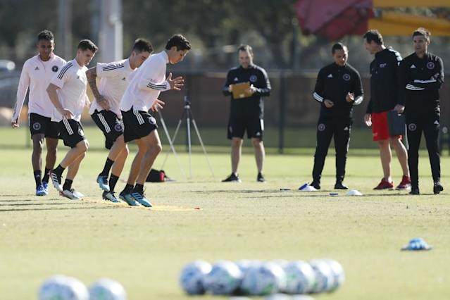 """Inter Miami CF head coach Diego Alonso, right, watches players participate in drills during a team practice session in January. <span class=""""copyright"""">(Brynn Anderson / Associated Press)</span>"""