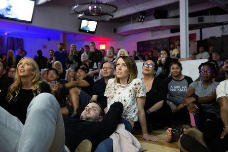 Fans react to the final episode of Game of Thrones at a watch party in the Manhattan borough of New York City