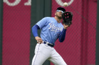 Kansas City Royals right fielder Hunter Dozier catches a fly ball for the out on Toronto Blue Jays' Bo Bichette during the first inning in the first baseball game of a doubleheader, Saturday, April 17, 2021, in Kansas City, Mo. (AP Photo/Charlie Riedel)