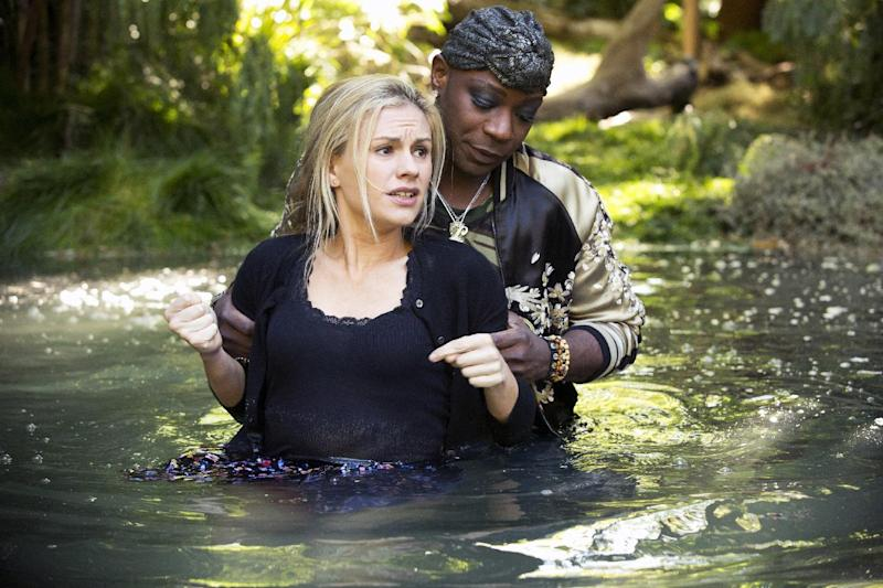 "This publicity photo released by HBO shows Anna Paquin, front, and Nelsan Ellis in HBO's TV series, ""True Blood,"" episode 65 (season 6, episode 5). (AP Photo, HBO, John P. Johnson)"