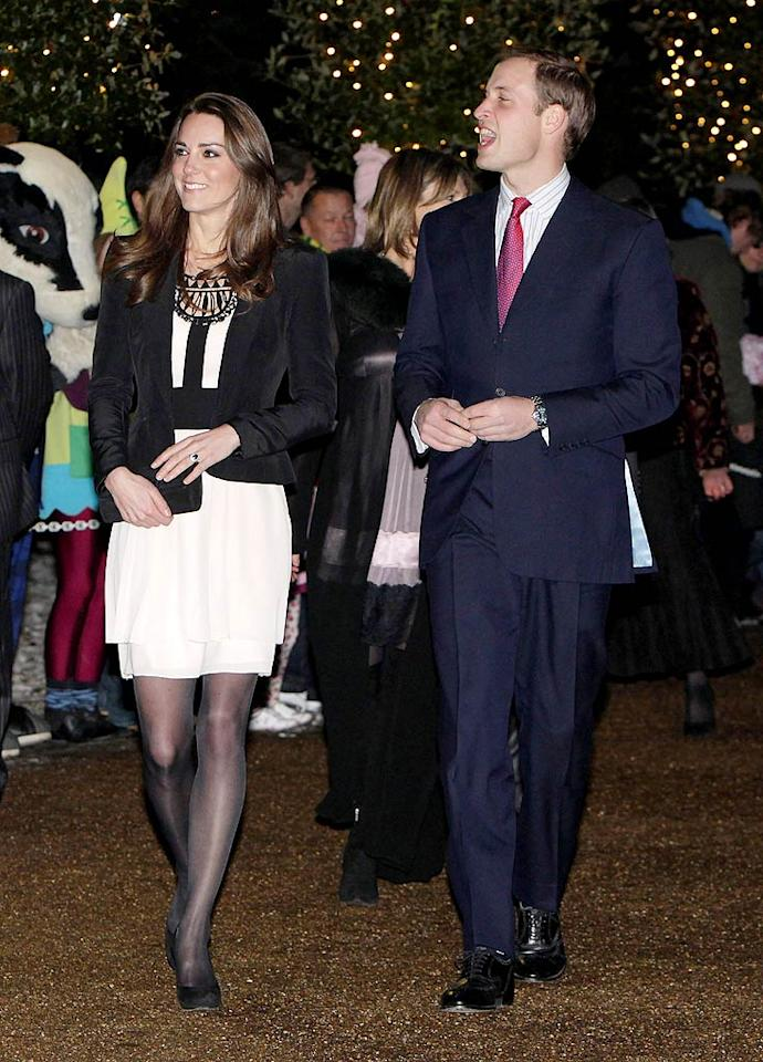 """Also spreading holiday cheer were Prince William and his new fiancee Kate Middleton, who made their first official appearance as an engaged couple at a Christmas reception in aid of the British Teenager Cancer Trust in Norfolk, England. Chris Jackson/<a href=""""http://www.gettyimages.com/"""" target=""""new"""">GettyImages.com</a> - December 18, 2010"""