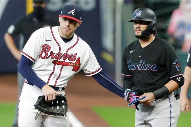 Back from virus, Freeman makes NLCS in 11th year for Braves