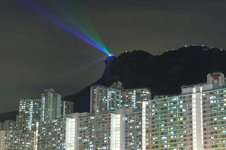 Anti-extradition bill protesters use laser beams as they form a human chain on top of the iconic Lion Rock, at Wong Tai Sin, during mid-autumn festival in Hong Kong