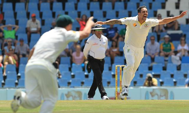 Australia's bowler Mitchell Johnson, right, celebrates his wicket as umpire Aleem Dar, center, of Pakistan watches on the fourth day of their their cricket test match against South Africa at Centurion Park in Pretoria, South Africa, Saturday, Feb. 15, 2014. (AP Photo/ Themba Hadebe)