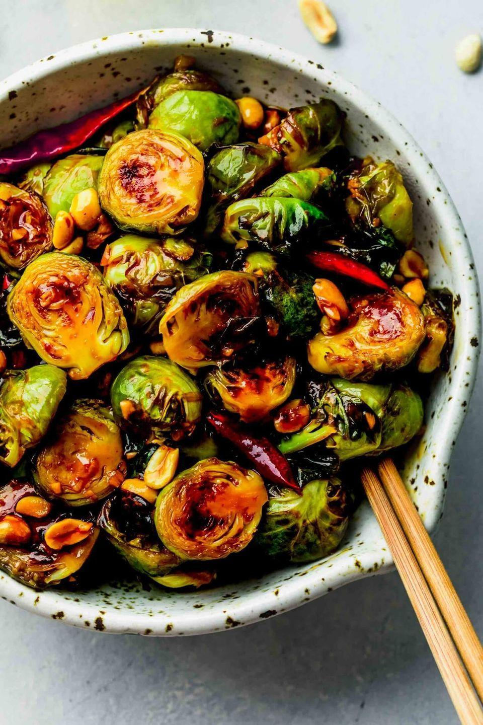 """<p>Inspired by Kung Pao chicken, these sprouts are coated in an addictive spicy-sweet sauce. Toss with roasted peanuts for an extra-crispy side. </p><p><strong>Get the recipe from <a href=""""https://www.platingsandpairings.com/kung-pao-brussels-sprouts/"""" rel=""""nofollow noopener"""" target=""""_blank"""" data-ylk=""""slk:Platings + Pairings"""" class=""""link rapid-noclick-resp"""">Platings + Pairings</a>.</strong></p>"""