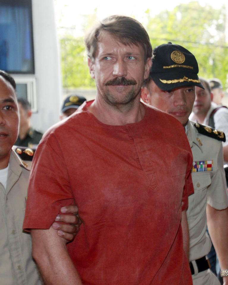 FILE - In this Aug. 20, 2010 file photo, Viktor Bout, a suspected Russian arms dealer, is escorted by prison officials as he arrives at the criminal court in Bangkok, Thailand. Bout appeared at a pretrial hearing in New York, Thursday, March 3, 2011, where a judge pushed his trial date to back October 11. Bout is charged with attempting to sell weapons to a terrorist group.
