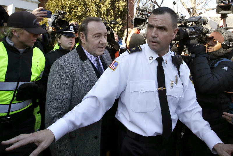 Actor Kevin Spacey, center left, departs district court on Monday, Jan. 7, 2019, in Nantucket, Mass., after his arraignment on a charge of indecent assault and battery. The Oscar-winning actor is accused of groping the teenage son of a former Boston TV anchor in 2016 in the crowded bar at the Club Car in Nantucket. (AP Photo/Steven Senne)