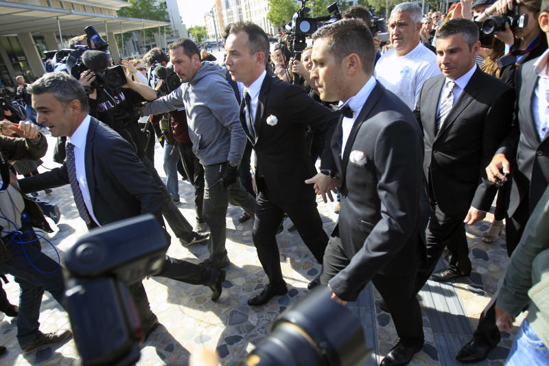 Vincent Autin, center left, and Bruno Boileau, center, arrive at Montpelier City Hall, for their civil wedding, Wednesday May 29, 2013.  Bruno Boileau, 30, from Paris and Vincent Autin, 40, are the first same-sex couple to marry in France, since French government voted a new law legalizing same-sex marriage. (AP Photo/Remy de la Mauviniere)
