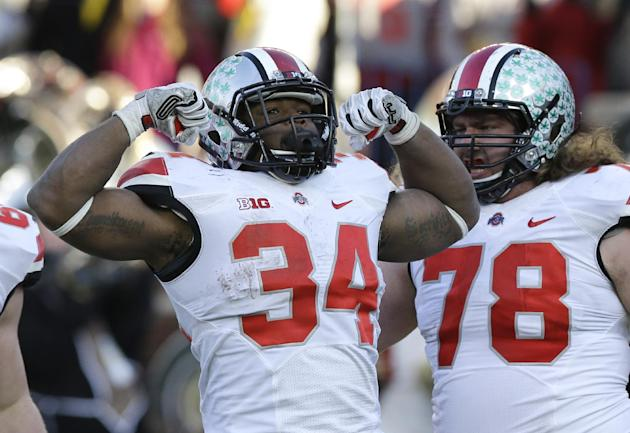 Carlos Hyde had plenty reason to celebrate with 226 rushing yards and a TD in OSU's win. (AP)