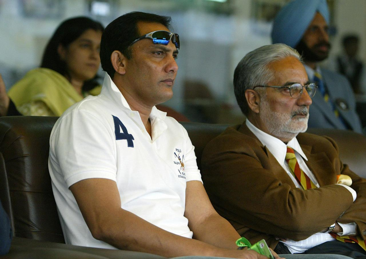 Mohali, INDIA:  Former Indian cricketer Mohammad Azharuddin (L) and Punjab Cricket Association President I. S. Bindra (R) watch play during the first semi-final for The ICC Champions Trophy 2006 between New Zealand and Australia at The Punjab Cricket Association (PCA) Stadium in Mohali, 01 November 2006. Australia are 220 runs for the loss of six wickets in 46 overs after New Zealand cricket captain Stephen Fleming won the toss and elected to field.  AFP PHOTO/Prakash SINGH  (Photo credit should read PRAKASH SINGH/AFP/Getty Images)