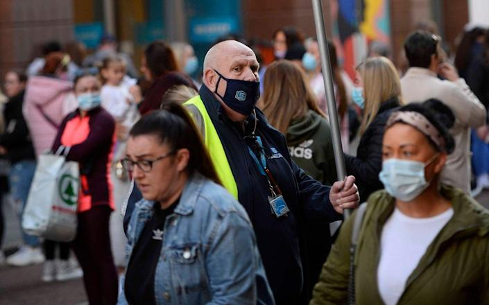 Shoppers queue outside Primark in Belfast as shops reopen - Mark Marlow/PA