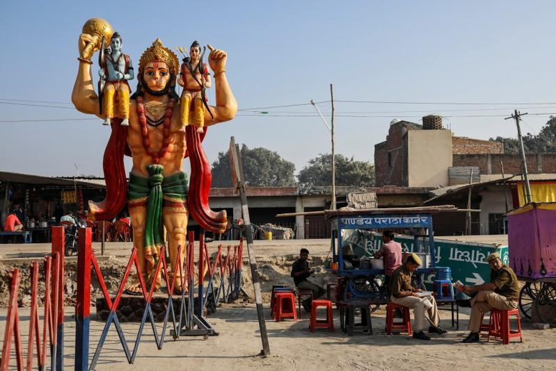 A statue of Hindu monkey god Hanuman is seen next to security barricade as police officers take a break after Supreme Court's verdict on a disputed religious site, in Ayodhya
