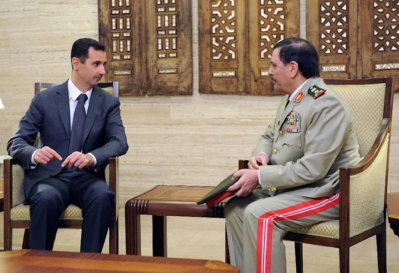 A picture released by the official Syrian Arab News Agency (SANA) on July 19, 2012, shows defence minister Fahed Jassem al-Freij (R) meeting with President Bashar al-Assad in Damascus