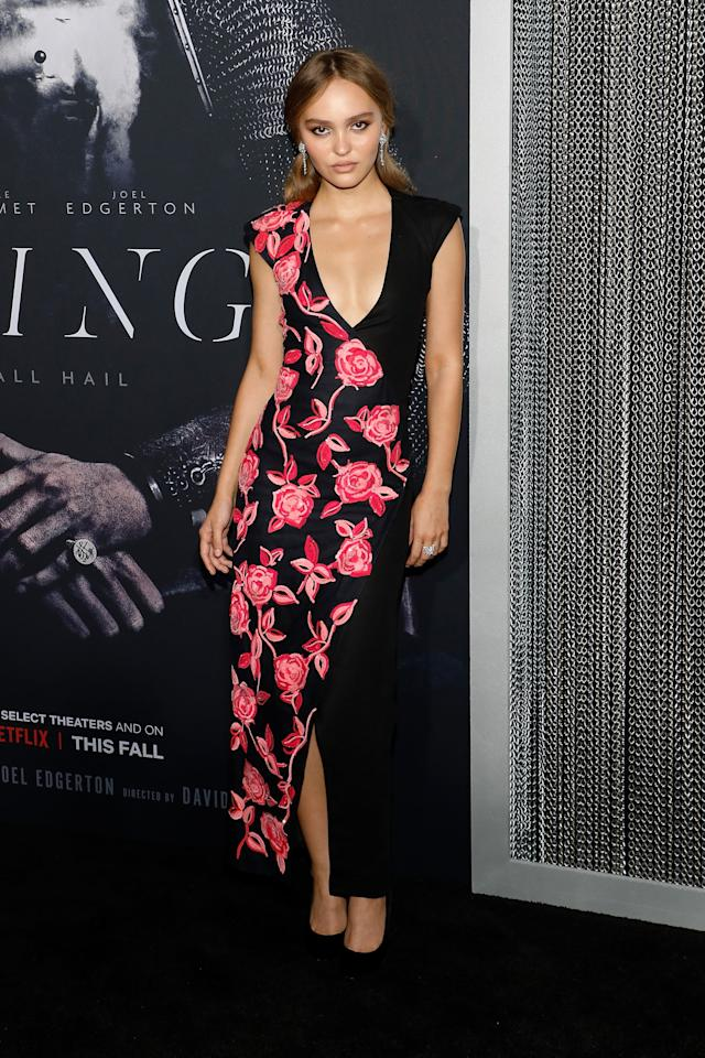 """<p>Lily-Rose Depp wore a <a href=""""https://www.popsugar.com/fashion/lily-rose-depp-dress-at-king-premiere-46705156"""" class=""""ga-track"""" data-ga-category=""""Related"""" data-ga-label=""""https://www.popsugar.com/fashion/lily-rose-depp-dress-at-king-premiere-46705156"""" data-ga-action=""""In-Line Links""""> low-cut Chanel wrap dress</a> with a pink floral print to <strong>The King</strong>'s premiere in New York.</p>"""