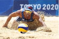 <p>The United States's Nicholas Lucena dives for the ball against Qatar during the men's beach volleyball competition.</p>